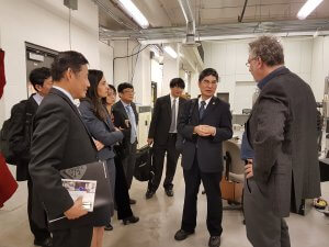 Tracey Forrest giving a tour of TQT facilities to the Minister of Science and Technology of Taiwan and guests