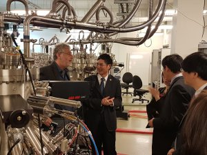The Minister of Science and Technology of Taiwan and guests looking at a piece of lab equipment