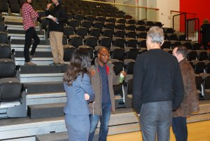 Dr. Dembo and Tracey Forrest talking to two lecture attendees.