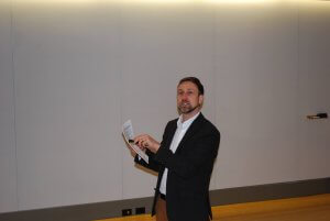 Lunch and Learn presenter pointing to a piece of paper