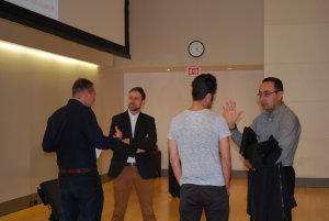 Four Lunch and Learn attendees talking to each other