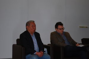 Two of the panelists at the front of the room.