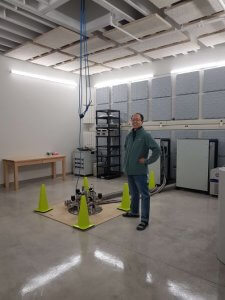 Person posing for the camera in the RAC sound proof room during an open house