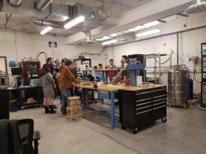 Open house attendees in a RAC 2 lab