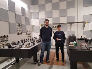 Two people posing for the camera in the RAC sound proof room during an open house